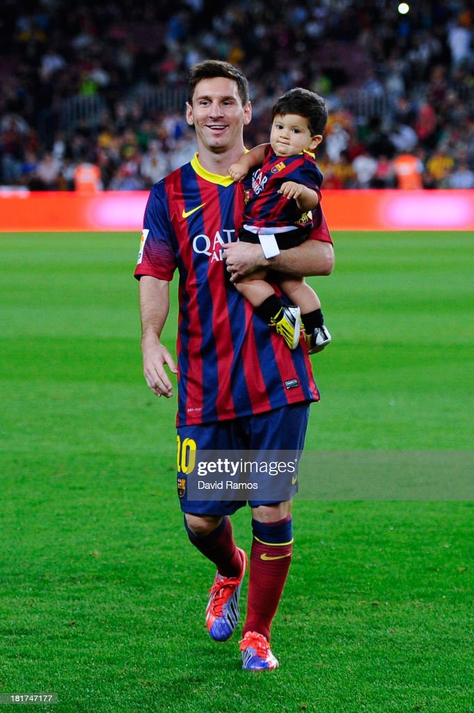 <a gi-track='captionPersonalityLinkClicked' href=/galleries/search?phrase=Lionel+Messi&family=editorial&specificpeople=453305 ng-click='$event.stopPropagation()'>Lionel Messi</a> of FC Barcelona with his son Thiago walk out the pitch prior to the La Liga match between FC Barcelona and Real Sociedad de Futbol at Camp Nou on September 24, 2013 in Barcelona, Spain.