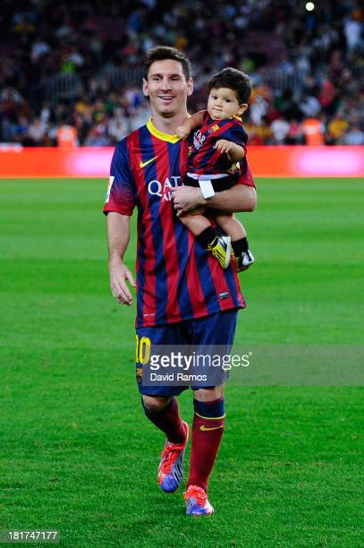 Lionel Messi of FC Barcelona with his son Thiago walk out the pitch prior to the La Liga match between FC Barcelona and Real Sociedad de Futbol at...