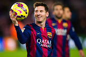 Lionel Messi of FC Barcelona with the match ball after scoring three goals during the La Liga match between FC Barcelona and RCD Espanyol at Camp Nou...