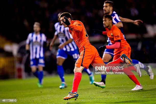 Lionel Messi of FC Barcelonar scores their opening goal from a header during the La Liga match between RC Deportivo La Coruna and FC Barcelona at...