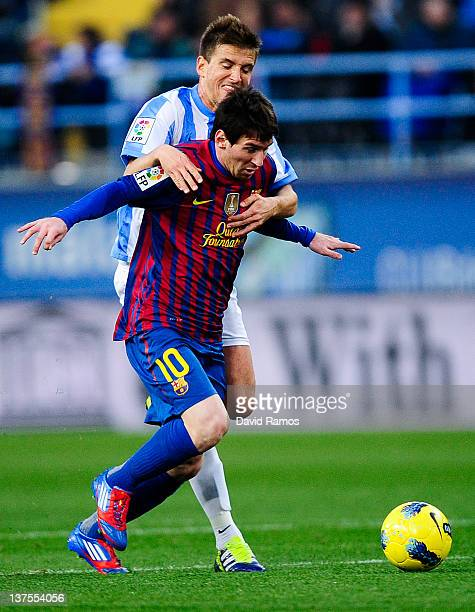 Lionel Messi of FC Malaga duels for the ball with Ignacio Camacho of Malaga FC during the La Liga match between Malaga CF and FC Malaga at Rosalada...