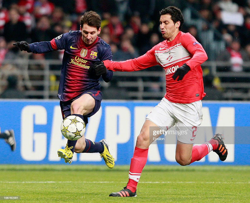 Lionel Messi (L) of FC Spartak Moscow battles for the ball with Juan Insaurralde of FC Barcelona during the UEFA Champions League group G match between FC Spartak Moscow and FC Barcelona at the Luzhniki Stadium on November 20, 2012 in Moscow, Russia.