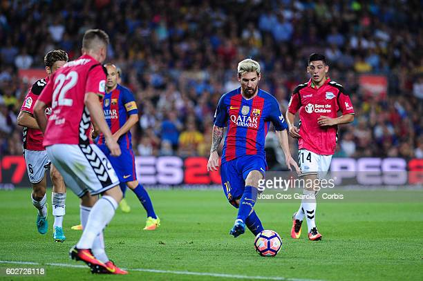 Lionel Messi of FCBarcelona shooting the ball in front of Carlos Vigray of Deportivo Alavés during the Spanish League match between FC Barcelona vs...