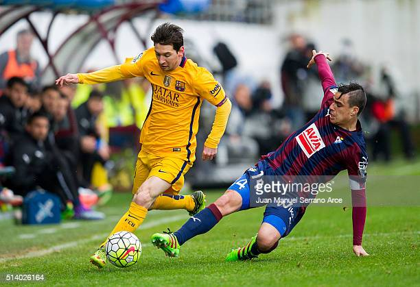 Lionel Messi of SD Eibar duels for the ball with Daniel Garcia of FC Barcelona during the La Liga match between SD Eibar and FC Barcelona at Ipurua...