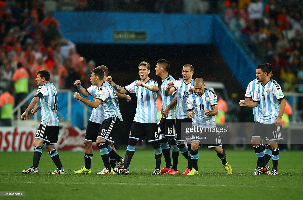 Lionel Messi, Pablo Zabaleta, Martin Demichelis, Lucas Biglia, Marcos Rojo, Rodrigo Palacio, Javier Mascherano, Ezequiel Garay and Maxi Rodriguez of Argentina react after a made penalty kick by teammate Sergio Aguero (not pictured) during the 2014 FIFA World Cup Brazil Semi Final match between the Netherlands and Argentina at Arena de Sao Paulo on July 9, 2014 in Sao Paulo, Brazil.