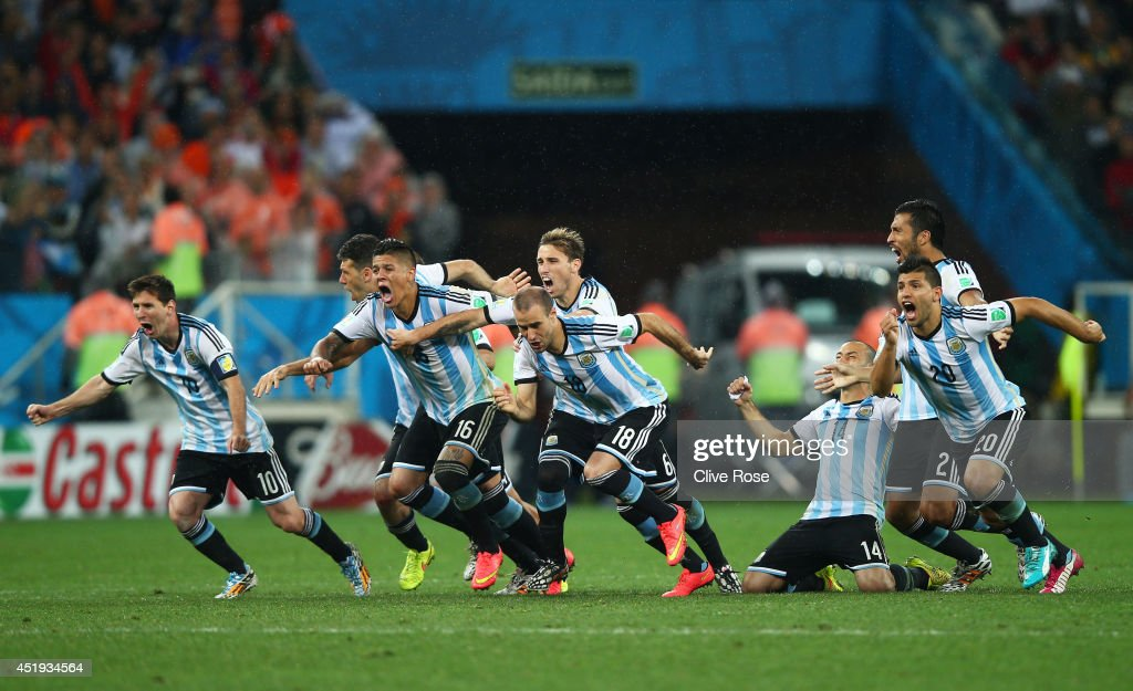 Lionel Messi, Pablo Zabaleta, Martin Demichelis, Marcos Rojo, Lucas Biglia, Javier Mascherano, Rodrigo Palacio and Ezequiel Garay of Argentina celebrate defeating the Netherlands in a penalty shootout during the 2014 FIFA World Cup Brazil Semi Final match between the Netherlands and Argentina at Arena de Sao Paulo on July 9, 2014 in Sao Paulo, Brazil.