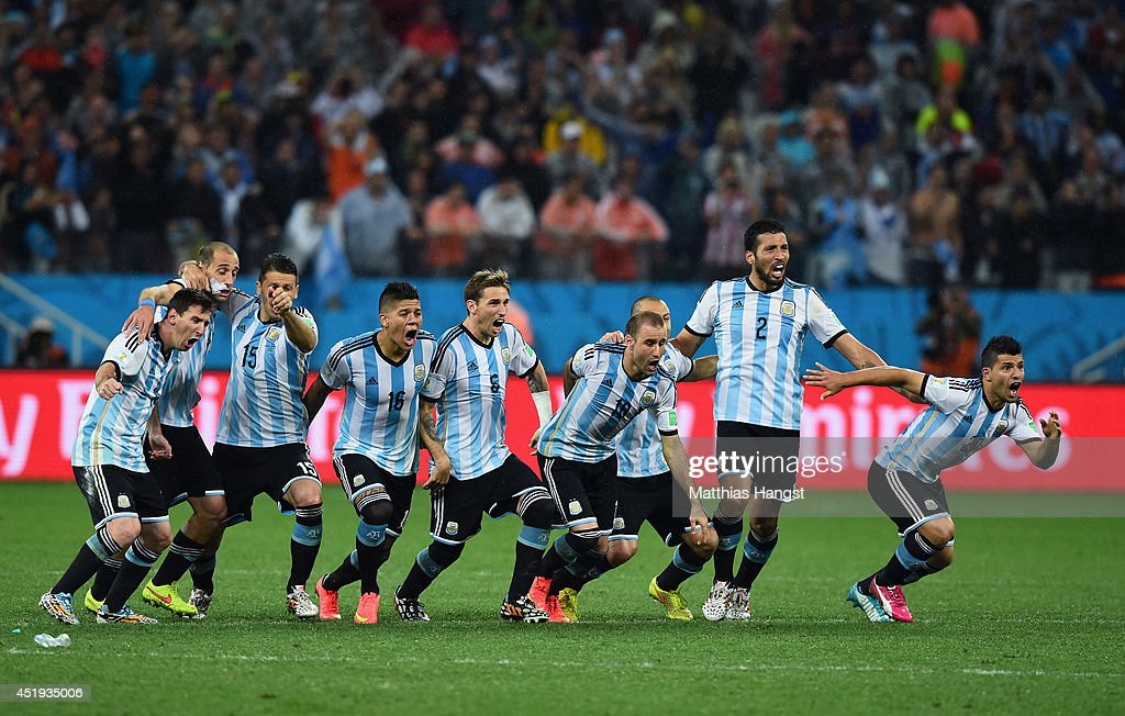 Lionel Messi, Pablo Zabaleta, Martin Demichelis, Marcos Rojo, Lucas Biglia, Javier Mascherano, Rodrigo Palacio , Ezequiel Garay and Sergio Aguero of Argentina celebrate defeating the Netherlands in a shootout during the 2014 FIFA World Cup Brazil Semi Final match between the Netherlands and Argentina at Arena de Sao Paulo on July 9, 2014 in Sao Paulo, Brazil.