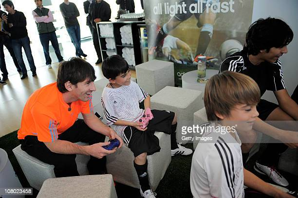 Lionel Messi plays playstation during the launch of the new adiZero footwear range from adidas on January 13 2011 in Barcelona Spain