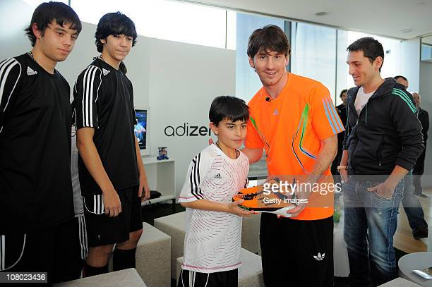Lionel Messi receives the new F50 adiZero boot from the winners during the launch of the new adiZero footwear range from adidas on January 13 2011 in...