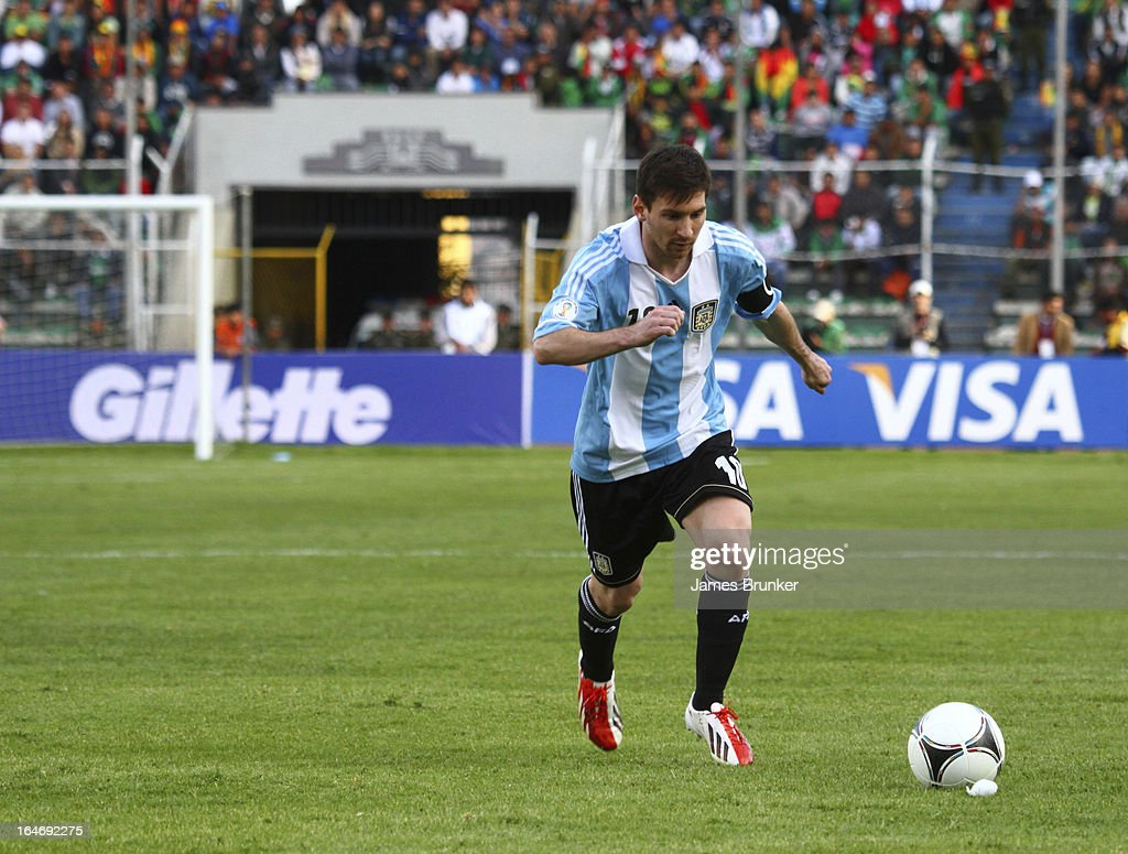 <a gi-track='captionPersonalityLinkClicked' href=/galleries/search?phrase=Lionel+Messi&family=editorial&specificpeople=453305 ng-click='$event.stopPropagation()'>Lionel Messi</a> shoot a free kick during a match between Bolivia and Argentina as part of the 12th round of the South American Qualifiers for the FIFA World Cup Brazil 2014 at the Hernando Siles Stadium on March 26, 2013 in La Paz, Bolivia.