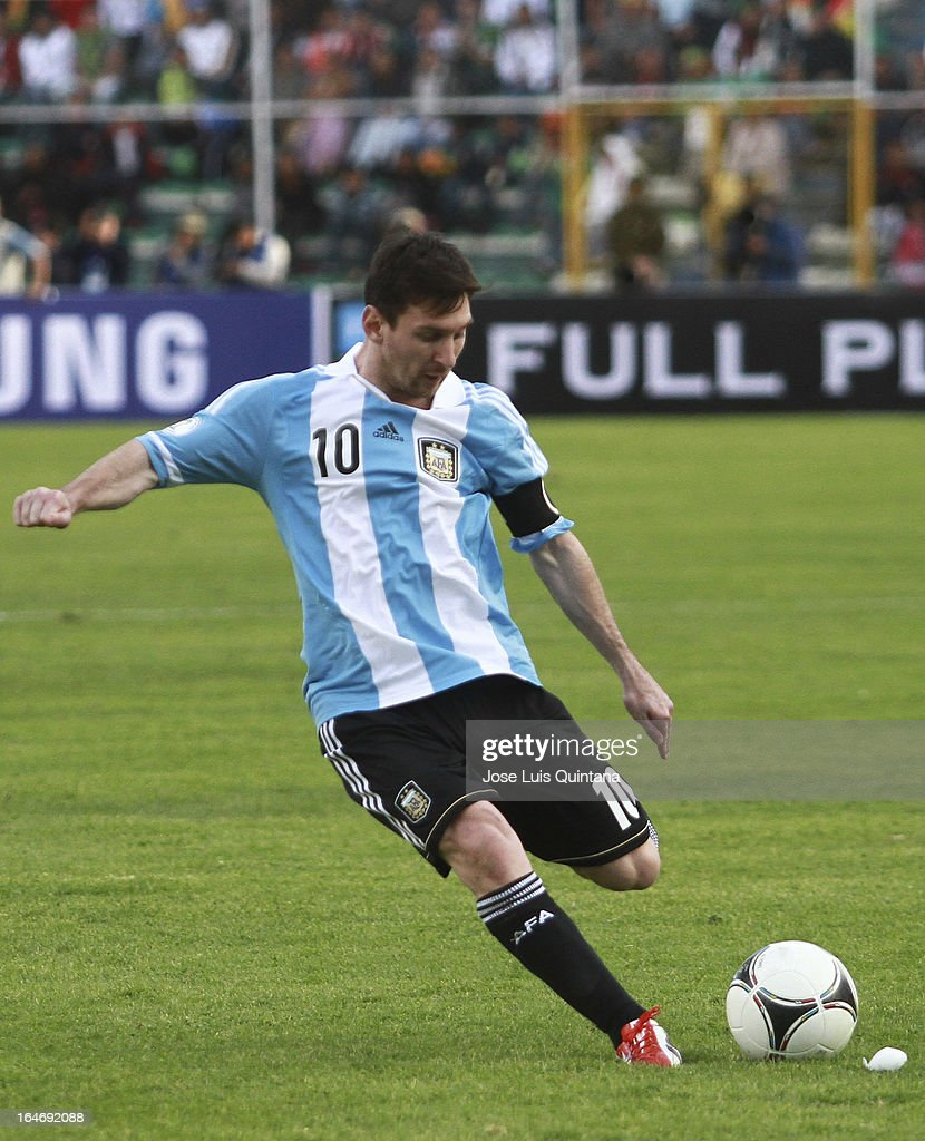 <a gi-track='captionPersonalityLinkClicked' href=/galleries/search?phrase=Lionel+Messi&family=editorial&specificpeople=453305 ng-click='$event.stopPropagation()'>Lionel Messi</a> shoots the ball with his left leg during a match between Bolivia and Argentina as part of the 12th round of the South American Qualifiers for the FIFA World Cup Brazil 2014 at the Hernando Siles Stadium on March 26, 2013 in La Paz, Bolivia.