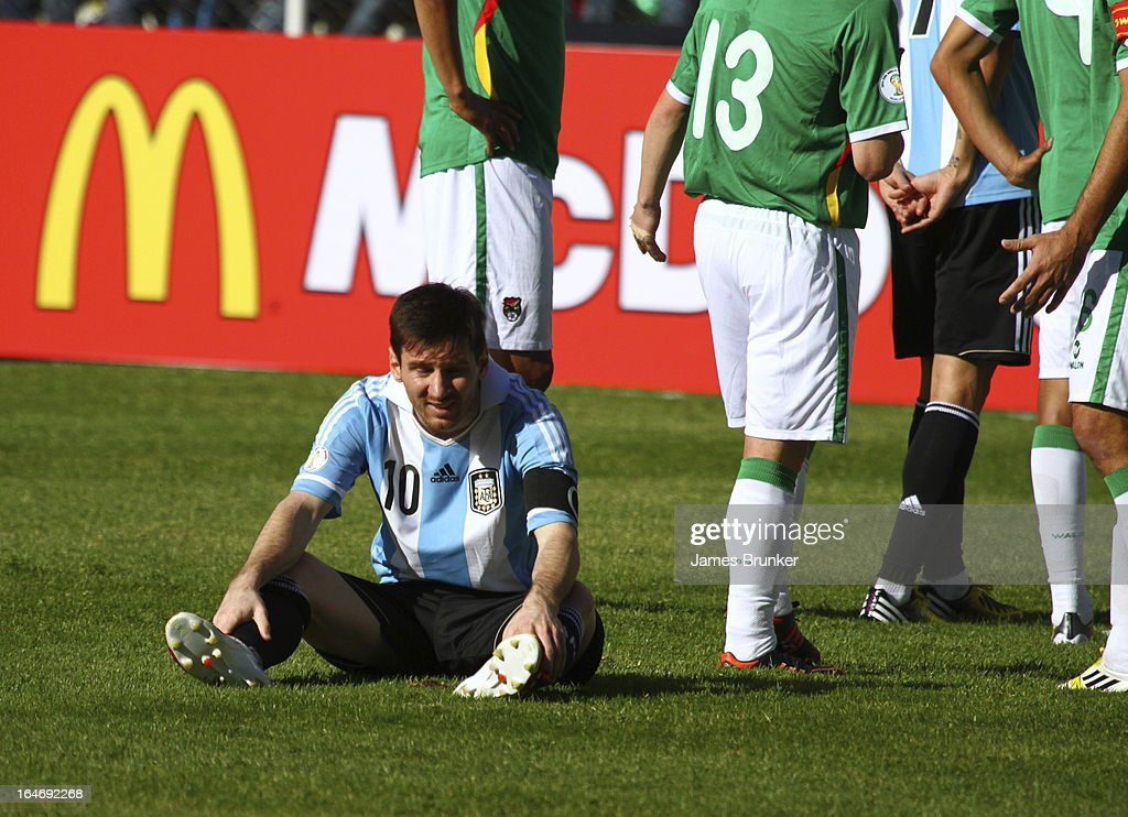 <a gi-track='captionPersonalityLinkClicked' href=/galleries/search?phrase=Lionel+Messi&family=editorial&specificpeople=453305 ng-click='$event.stopPropagation()'>Lionel Messi</a> stretches on the floor during a match between Bolivia and Argentina as part of the 12th round of the South American Qualifiers for the FIFA World Cup Brazil 2014 at the Hernando Siles Stadium on March 26, 2013 in La Paz, Bolivia.
