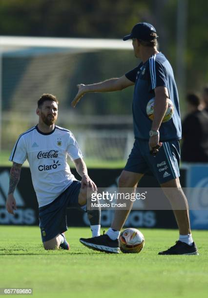 Lionel Messi talks with coach Edgardo Bauza during a training session at Argentine Football Association 'Julio Humberto Grondona' training camp on...