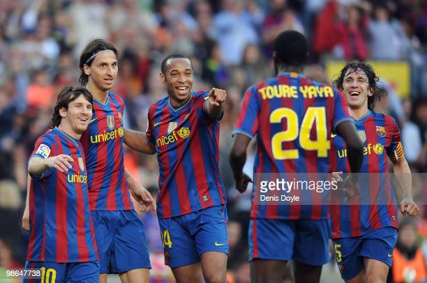 Lionel Messi Zlatan Ibrahimovic Thierry Henry and Carles Puyol of Barcelona celebrate after Ibrahimovic scored his team's third goal during the La...