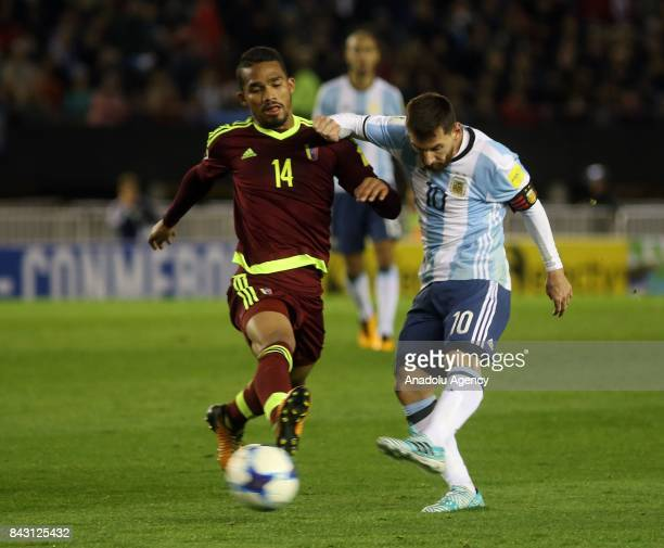 Lionel Messii of Argentina in action against Yangel Herrera of Venezuela during the FIFA 2018 World Cup Qualifiers football match between Argentina...