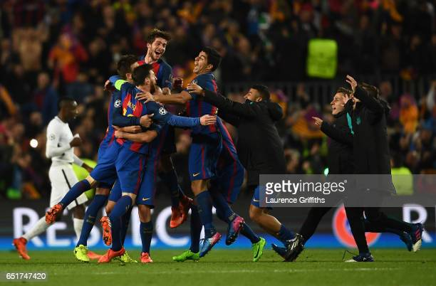 Lionel MessiSergio Roberto and Luis Suarez of Barcelona celebrate on the final whistle during the UEFA Champions League Round of 16 second leg match...