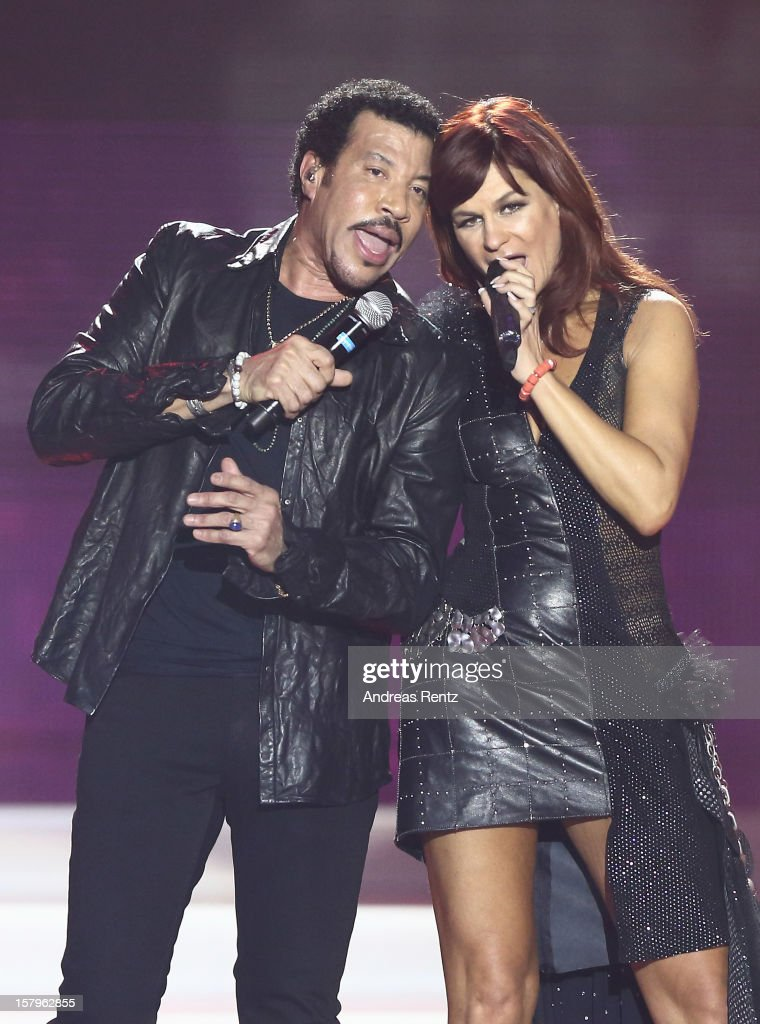 Lionel Richie and Andrea Berg perform on stage during the Andrea Berg 'Die 20 Jahre Show' at Baden Arena on December 7 2012 in Offenburg Germany