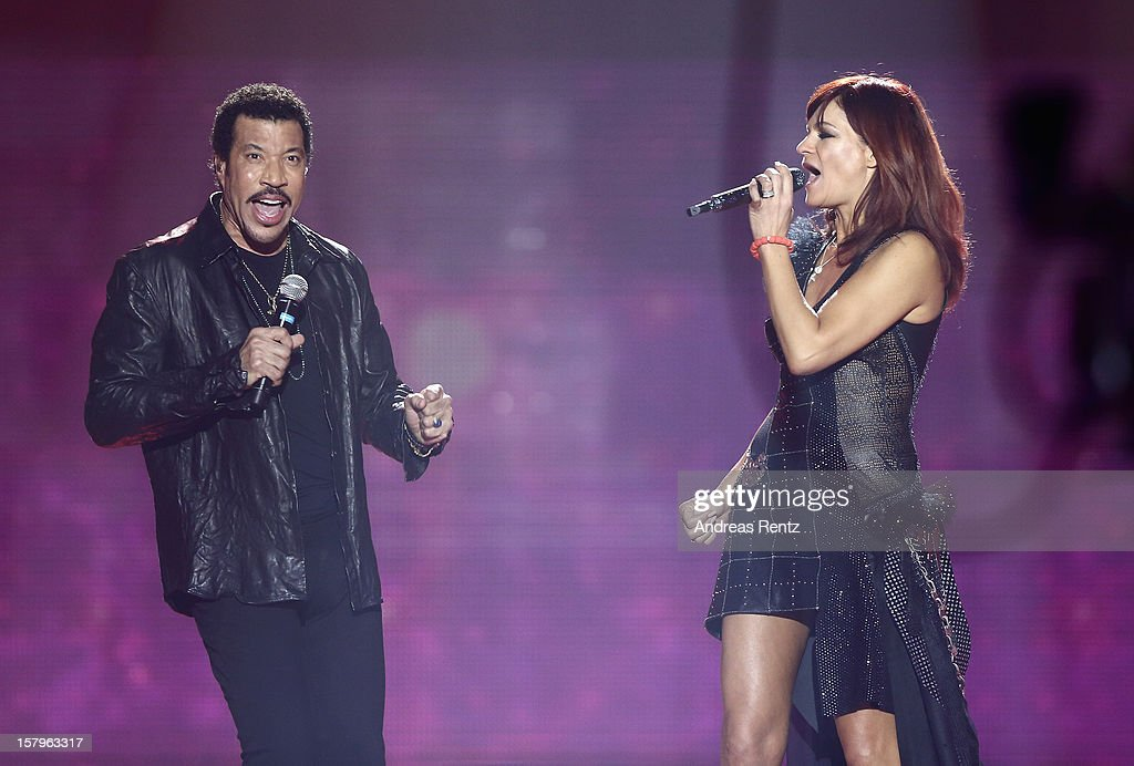 <a gi-track='captionPersonalityLinkClicked' href=/galleries/search?phrase=Lionel+Richie&family=editorial&specificpeople=204139 ng-click='$event.stopPropagation()'>Lionel Richie</a> and <a gi-track='captionPersonalityLinkClicked' href=/galleries/search?phrase=Andrea+Berg&family=editorial&specificpeople=2500874 ng-click='$event.stopPropagation()'>Andrea Berg</a> perform on stage during the <a gi-track='captionPersonalityLinkClicked' href=/galleries/search?phrase=Andrea+Berg&family=editorial&specificpeople=2500874 ng-click='$event.stopPropagation()'>Andrea Berg</a> 'Die 20 Jahre Show' at Baden Arena on December 7, 2012 in Offenburg, Germany.