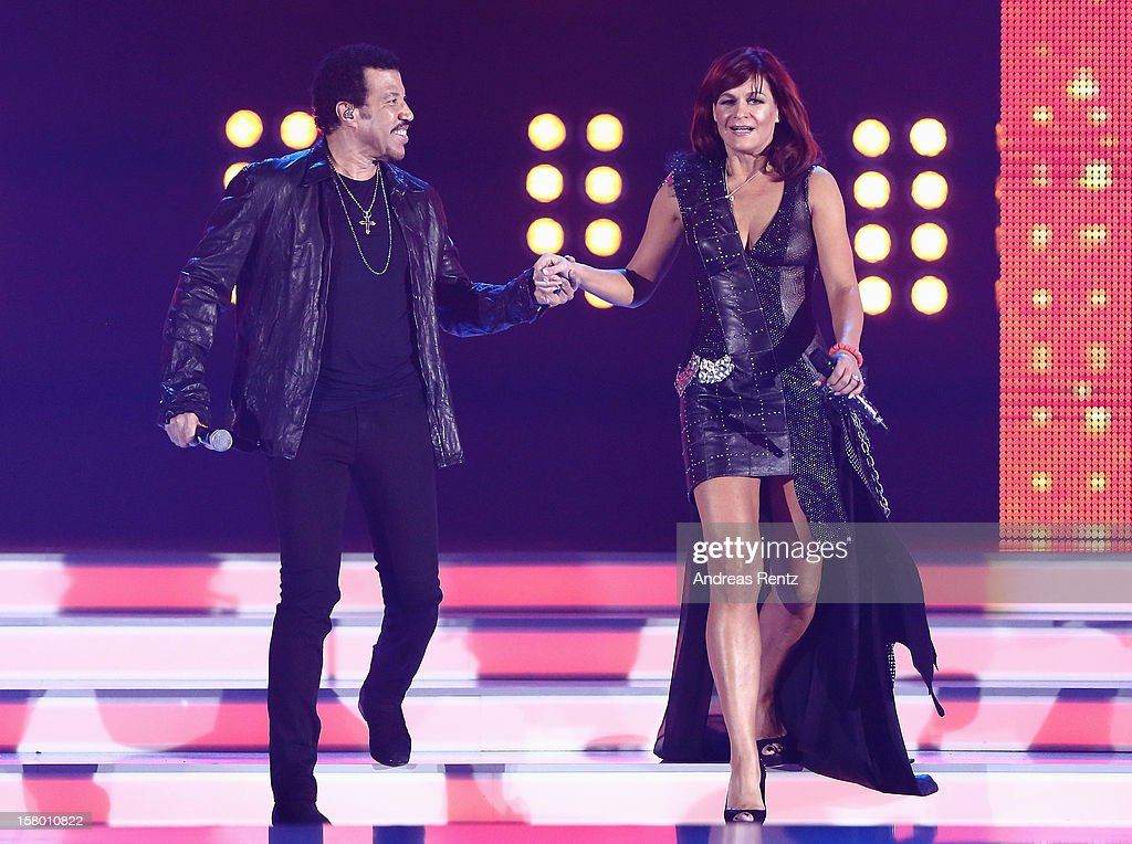Lionel Richie and Andrea Berg perform on stage during the Andrea Berg 'Die 20 Jahre Show' at Baden Arena on December 7, 2012 in Offenburg, Germany.