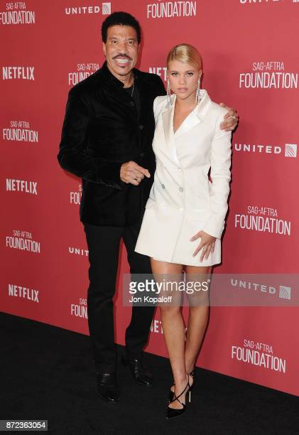 Lionel Richie and daughter Sofia Richie arrive at SAGAFTRA Foundation Patron of the Artists Awards 2017 on November 9 2017 in Beverly Hills California