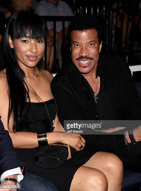 Lionel Richie and guest attend the 2014 CMT Music awards at the Bridgestone Arena on June 4 2014 in Nashville Tennessee