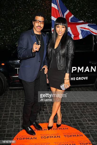 Lionel Richie and guest attend the Topshop Topman LA Opening Party held at Cecconi's Restaurant on February 13 2013 in Los Angeles California