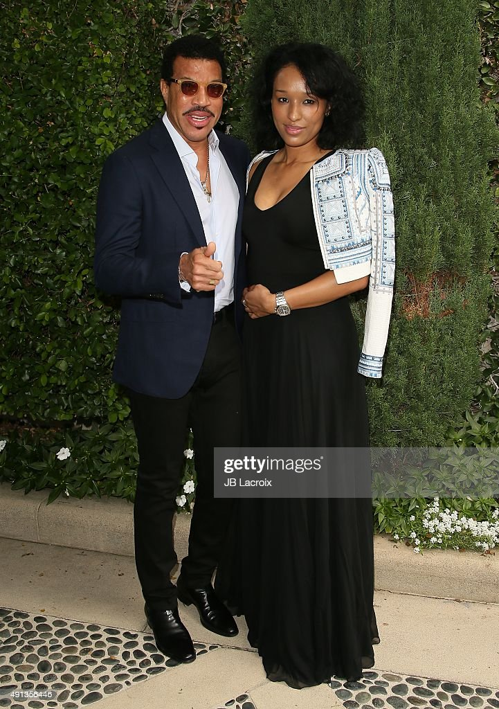 Lionel Richie and Lisa Parigi attend the Rape Foundation's Annual Brunch held at the Greenacres, the private estate of Ron Burkle, on October 4, 2015 in Beverly Hills, California.