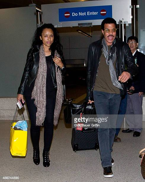 Lionel Richie and Lisa Parigi seen at LAX on September 27 2014 in Los Angeles California