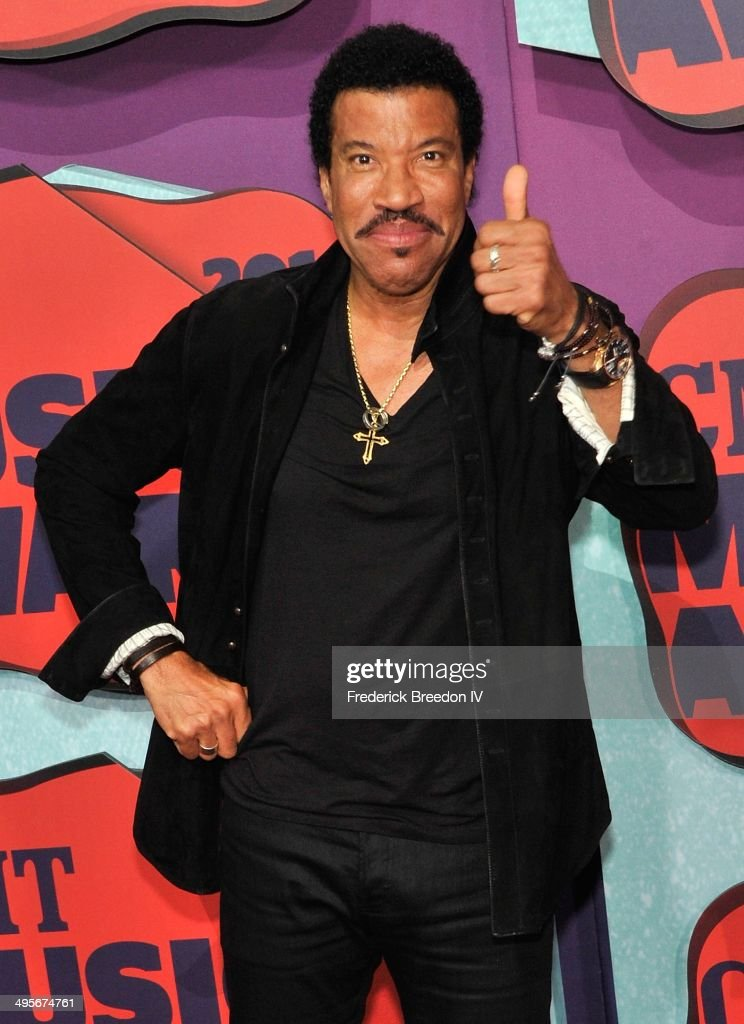 <a gi-track='captionPersonalityLinkClicked' href=/galleries/search?phrase=Lionel+Richie&family=editorial&specificpeople=204139 ng-click='$event.stopPropagation()'>Lionel Richie</a> arrives at the 2014 CMT Music awards at the Bridgestone Arena on June 4, 2014 in Nashville, Tennessee.