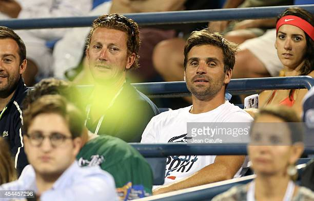 Lionel Roux and Arnaud Clement Davis Cup Captain of France attend Day 7 of the 2014 US Open at USTA Billie Jean King National Tennis Center on August...