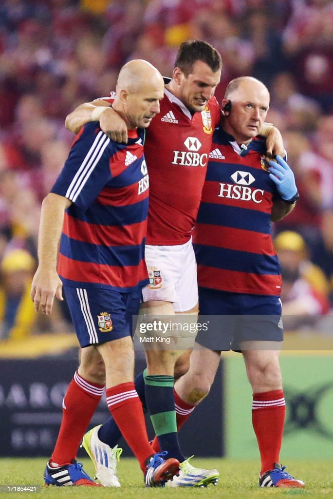 Lions captain <a gi-track='captionPersonalityLinkClicked' href=/galleries/search?phrase=Sam+Warburton+-+Rugby+Player&family=editorial&specificpeople=4234449 ng-click='$event.stopPropagation()'>Sam Warburton</a> is assisted from the field with a hamstring injury during game two of the International Test Series between the Australian Wallabies and the British & Irish Lions at Etihad Stadium on June 29, 2013 in Melbourne, Australia.
