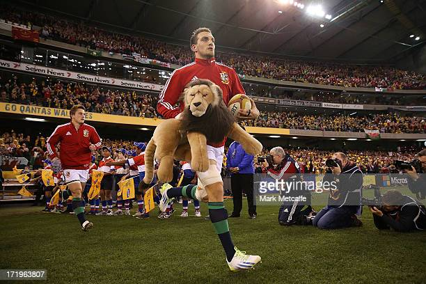 Lions captain Sam Warburton runs out onto the field before game two of the International Test Series between the Australian Wallabies and the British...