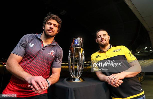 Lions captain Warren Whiteley and Hurricanes captain Dane Coles pose for a photo with the Super Rugby trophy during the Super Rugby Final media...