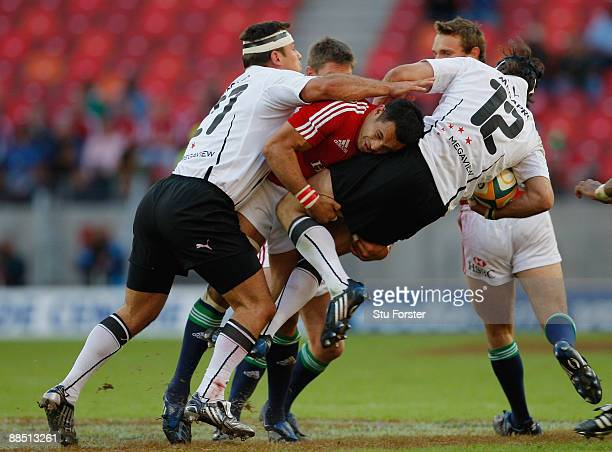 Lions centre Riki Flutey puts in a big tackle on De Wet Barry of the Southern Kings during the game between Southern Kings and British Irish Lions at...