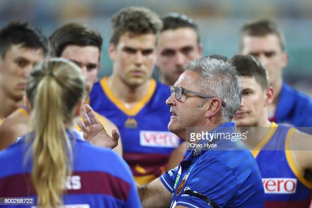 Lions coach Chris Fagan talks to players during the round 14 AFL match between the Brisbane Lions and the Greater Western Sydney Giants at The Gabba...
