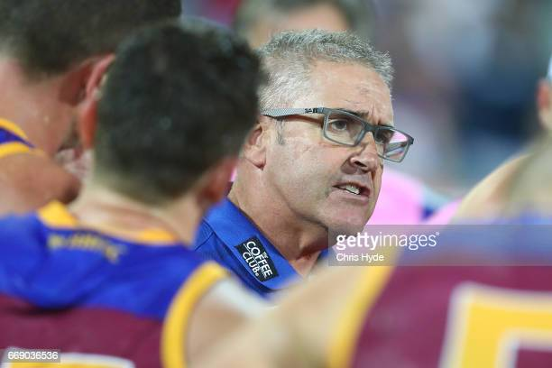 Lions coach Chris Fagan talks to players during the round four AFL match between the Brisbane Lions and the Richmond Tigers at The Gabba on April 16...