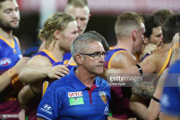 Lions coach Chris Fagan talks to players during the round two AFL match between the Brisbane Lions and the Essendon Bombers at The Gabba on April 1...