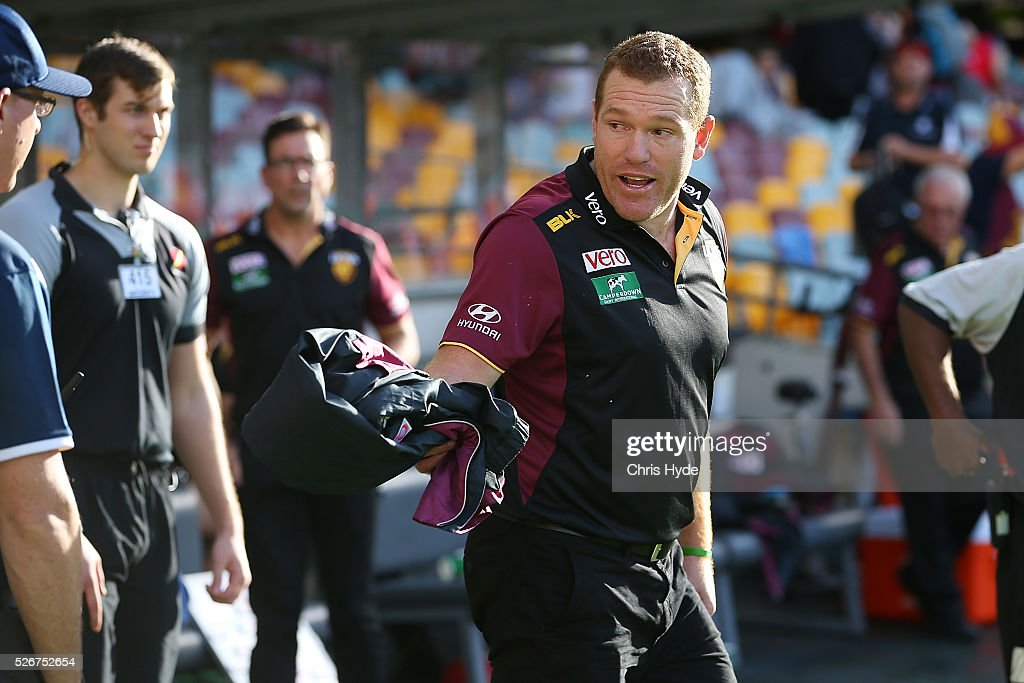 Lions coach Justin Leppitsch speaks to an official after the match during the round six AFL match between the Brisbane Lions and the Sydney Swans at The Gabba on May 1, 2016 in Brisbane, Australia.