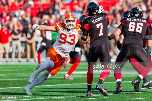 Lions defensive lineman Craig Roh arrives a second late on this attempt to sack Ottawa RedBlacks quarterback Trevor Harris during Canadian Football...