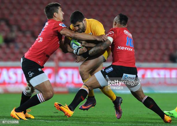 Lions Elton Jantjies and Harold Voster tackles Jaguares Jeronimo de la Fuente during the SUPERXV rugby union match between Lions and Jaguares at...