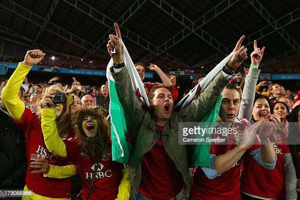 Lions fans celebrate the Lions victory in the International Test match between the Australian Wallabies and British Irish Lions at ANZ Stadium on...