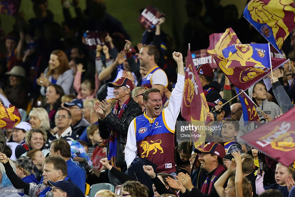 Lions fans celebrate winning the round 13 AFL match between the Brisbane Lions and the Geelong Cats at The Gabba on June 23, 2013 in Brisbane, Australia.