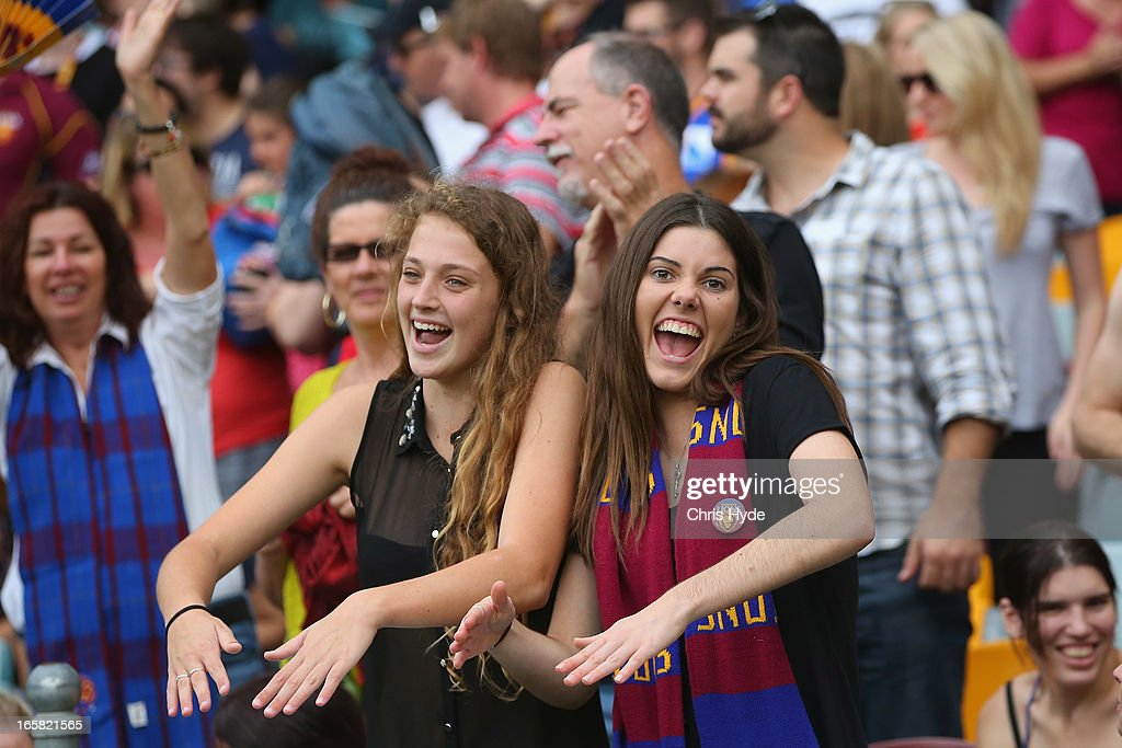 Lions fans cheer during the round two AFL match between the Brisbane Lions and the Adelaide Crows at The Gabba on April 6, 2013 in Brisbane, Australia.