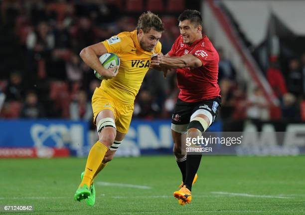Lions' Harold Voster vies with Jaguares' Rodrigo Baez during the SUPERXV rugby match between Lions and Jaguares at Ellis Park rugby stadium on April...