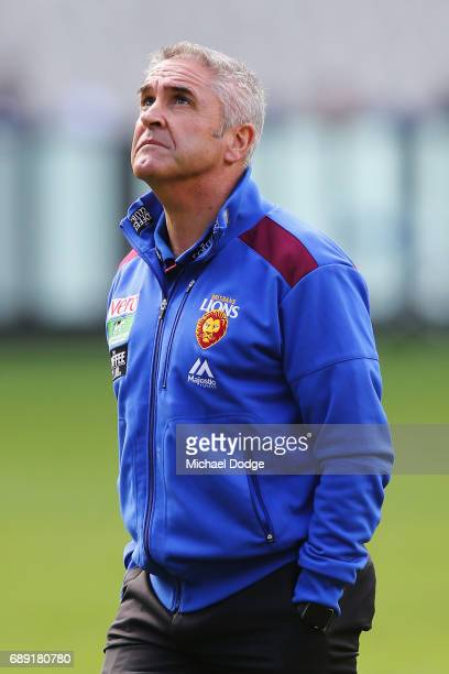 Lions head coach Chris Fagan surveys the conditions during the round 10 AFL match between the Collingwood Magpies and Brisbane Lions at Melbourne...