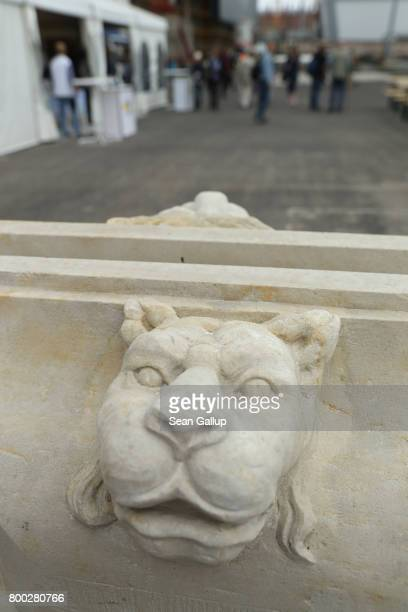 A lion's head decorates a facade element on display during open house day at the construction site of the Berlin City Palace which will house the...