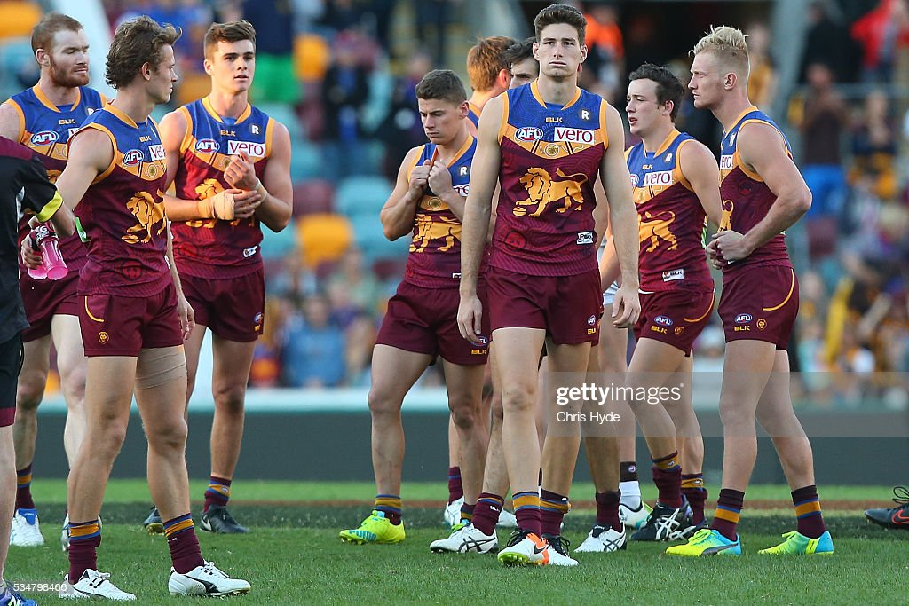 Lions leave the field after losing the round 10 AFL match between the Brisbane Lions and the Hawthorn Hawks at The Gabba on May 28, 2016 in Brisbane, Australia.