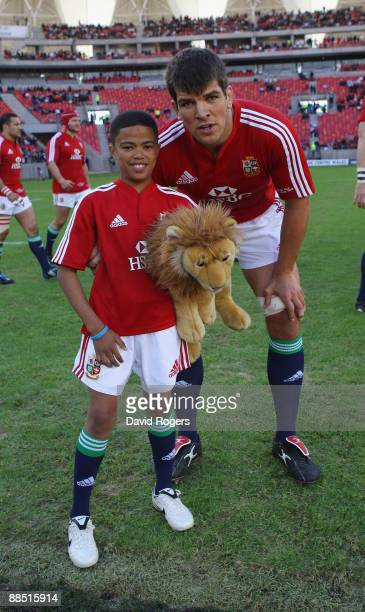 Lions match captain Donncha O'Callaghan poses with the mascot during the match between the Southern Kings and the British and Irish Lions on their...