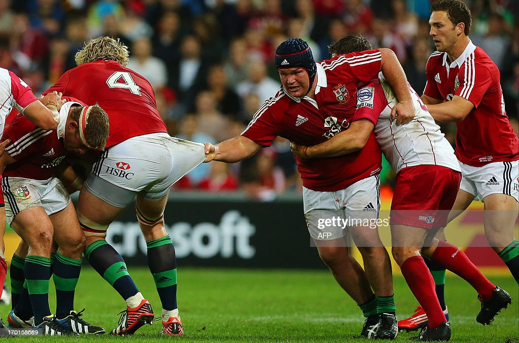 Lions player Matt Stevens (R) holds on to the shorts of teammate Richie Gray (L) during the rugby union tour match between the Queensland Reds and the British and Irish Lions at Suncorp Stadium in Brisbane on June 8, 2013. AFP PHOTO / Patrick HAMILTON USE