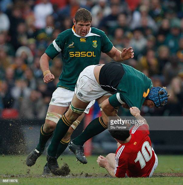 Lions player Stephen Jones tackles Juan Smith during the Third Test match between South Africa and The British and Irish Lions at Ellis Park Stadium...